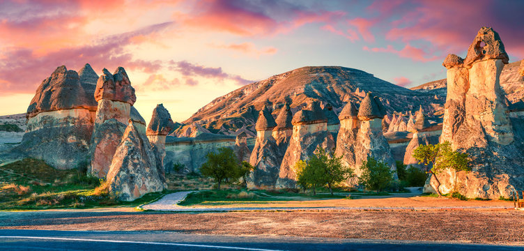 Impressive fungous forms of sandstone in the canyon near Cavusin village, Cappadocia, Nevsehir Province in the Central Anatolia Region of Turkey, Asia. Beauty of nature concept background.