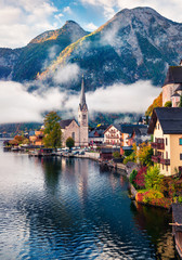 Sunny autumn scene of Hallstatt lake. Splendid morning viev of Hallstatt village, in Austria's...
