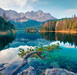 Splendid morning scene of Eibsee lake with Zugspitze mountain range on background. Colorful autumn view of Bavarian Alps, Germany, Europe. Beauty of nature concept background.