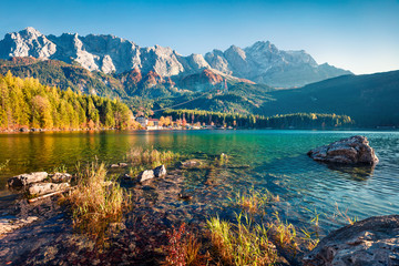 Marvelous evening scene of Eibsee lake with Zugspitze mountain range on background. Exciting autumn view of Bavarian Alps, Germany, Europe. Beauty of nature concept background.