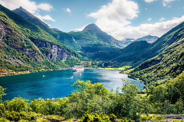 Splendid summer scene of Geiranger port, western Norway. Colorful view of Sunnylvsfjorden fjord. Traveling concept background. Artistic style post processed photo.