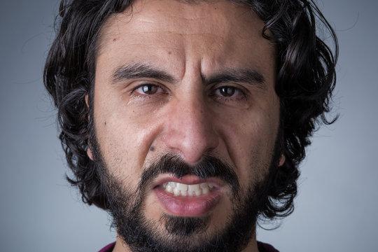 Angry Man with Beard and Long Hair Crying Looking at Camera