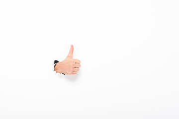 Obraz man showing thumb up from hole in paper wall on white with copy space - fototapety do salonu