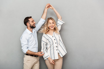 Photo closeup of joyful couple in casual clothing smiling and dancing