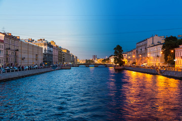 Time-lapse collage of day to night transition. Beautiful view of the Fontanka River and historic buildings from the Krasnoarmeyskiy bridge, Saint Petersburg, Russia Fotobehang