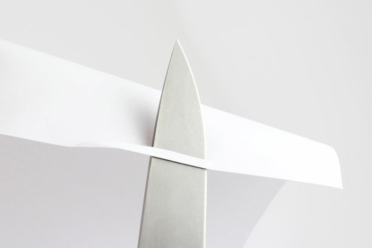 check the sharpening of knife blades on paper