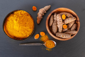 Turmeric on gray slate background. Top view overhead shot