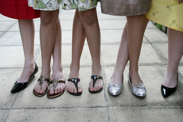 funny picture of 4 well dressed girls from the knees down with legs tangled