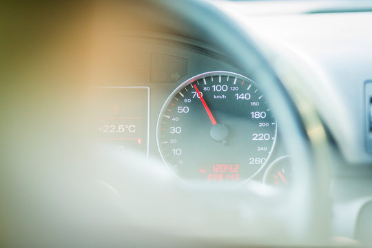 car dashboard and speedometer. kilometer of a car driving at 70, 80, 90 km / h.