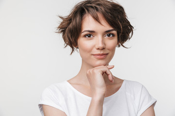 Portrait of cute woman with short brown hair in basic t-shirt looking at camera Fototapete