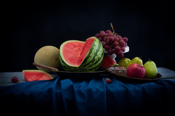 Still life with fresh watermelon and fruits on the table