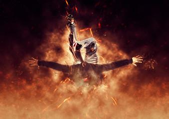Foto op Canvas Helicopter Man break dancing on fire background