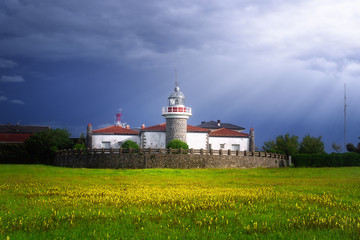 Getxo lighthouse in La Galea with beautiful stormy light