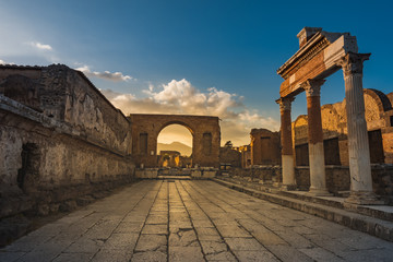 Ruins of ancient city of Pompeii, ancient roman city against Vesuvius volcano at sunset, Italy. Street in Pompeii Wall mural