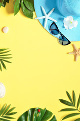 Tropical Background. Palm Trees Branches with starfish and seashell on yellow background. Travel....
