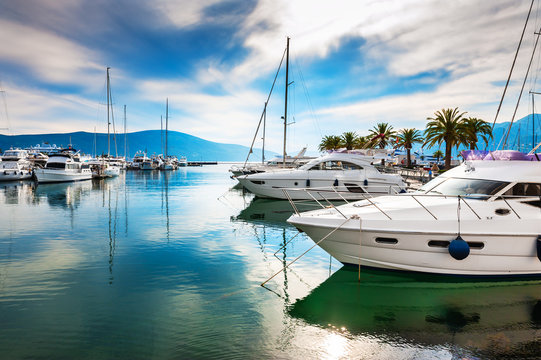 Luxury yachts in the sea port of Tivat, Montenegro. Kotor bay, Adriatic sea. Famous travel destination.