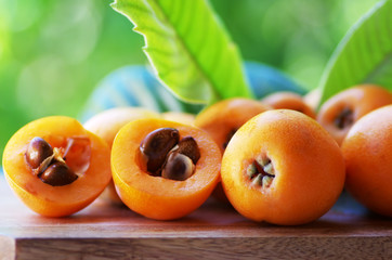 Loquat Medlar fruit isolated on a green background