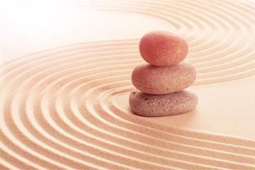 Obraz Zen stones in the sand. Beige background - fototapety do salonu