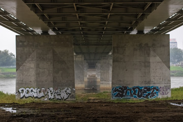 Under a bridge painted with street art