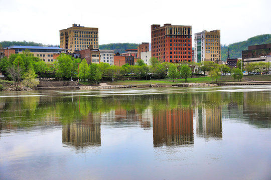 The skyline of Wheeling, West Virginia is reflected in the Ohio River