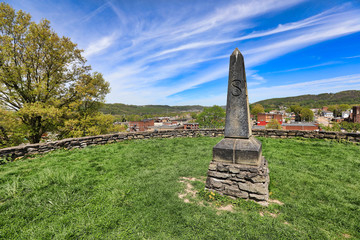 Moundsville, West virginia, just outside of Wheeling, is home to the Grave Creek Mound.  This historic landmark burial mound was built by the Arena people.