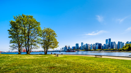 View of the Vancouver Skyline and Harbor. Viewed from the Stanley Park Seawall pathway in beautiful British Columbia, Canada Fototapete