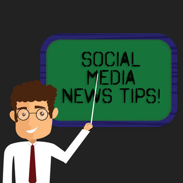 Writing note showing Social Media News Tips. Business photo showcasing Internet online communications new ways of knowledge Man Standing Holding Stick Pointing to Wall Mounted Blank Color Board