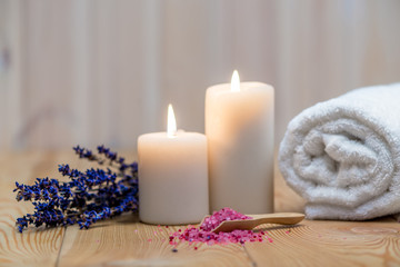 lavender, burning candles and sea salt for spa treatment and relaxation objects close up