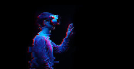 Man is using virtual reality headset. Image with glitch effect.