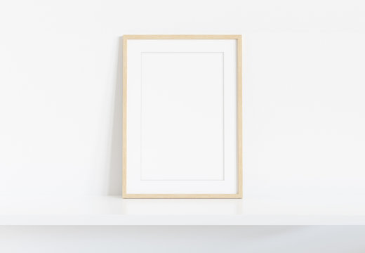 Wooden frame leaning on white shelve in bright interior mockup 3D rendering