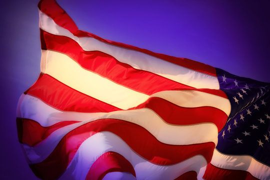 close up waving american flag over night sky