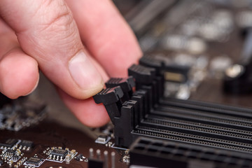 Male hand taking out ram memory on motherboard Wall mural