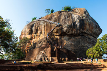 Sigiriya ancient Lion rock fortress in Sri Lanka with tourists Wall mural