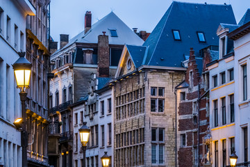 old classical city architecture with lighted lampposts in the city of antwerp, antwerpen, Belgium