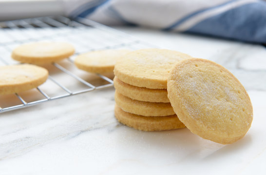 Freshly baked homemade butter shortbread biscuits dusted with sugar