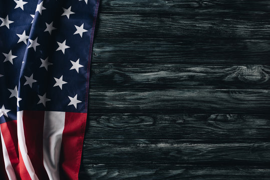 usa national flag on grey wooden surface, memorial day concept