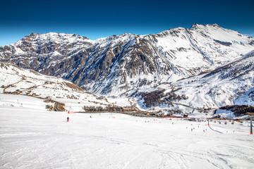 Wall Mural - Skiers skiing in Carosello 3000 ski resort, Livigno, Italy, Europe