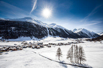 Fototapete - Livigno village covered by fresh snow, Livigno, Italy, Europe.