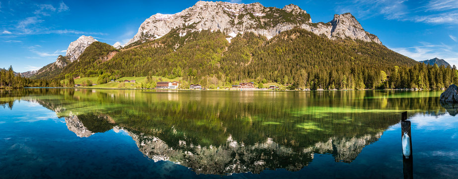 High resolution stitched panorama with reflections at the famous Hintersee near Ramsau - Bavaria - Germany