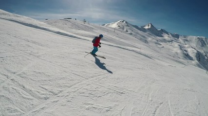 Fototapete - Young happy skier skiing in Italien Alps, Livigno, Italy, Europe.