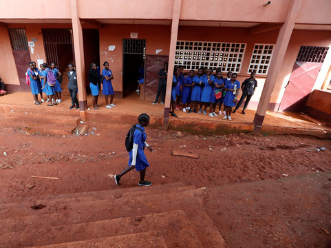 Gaelle Dule Asheri (C), 17, a soccer player, who is amongst the first wave of girls being trained by professional coaches at the Rails Foot Academy walks at a bilingual high school where she prepares for her final baccalaureate exams in Yaounde