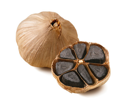 Black garlic bulbs isolated on white background