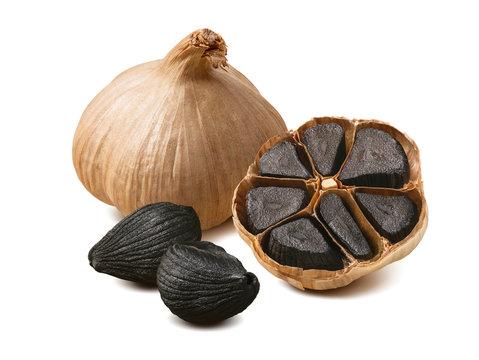 Black garlic cloves isolated on white background