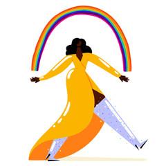 Woman walking under a rainbow