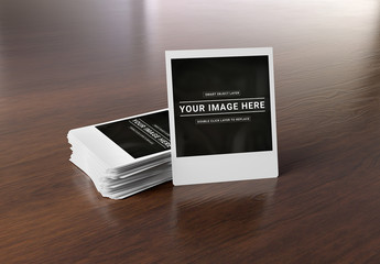 Stack of Instant Photos on Wooden Surface Mockup