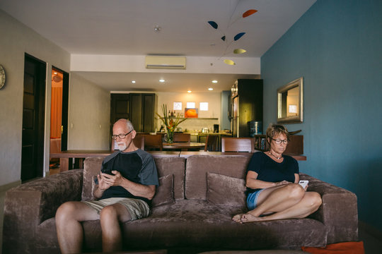 Couple using technolgy at home