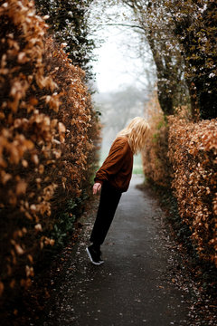 Side view of blond woman standing on road