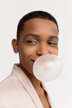 Androgynous woman blowing bubble with gum