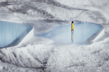 Scenic view of woman standing in water at Pamukkale, Turkey
