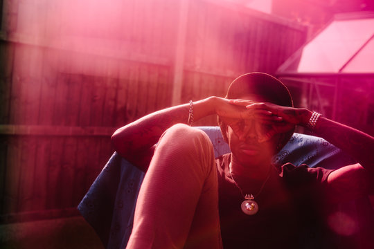 Cool black man in backyard, with light leaks